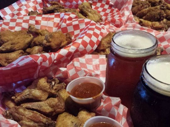 Enjoy the wing and beer specials during Guam's best happy hour at Horse and Cow