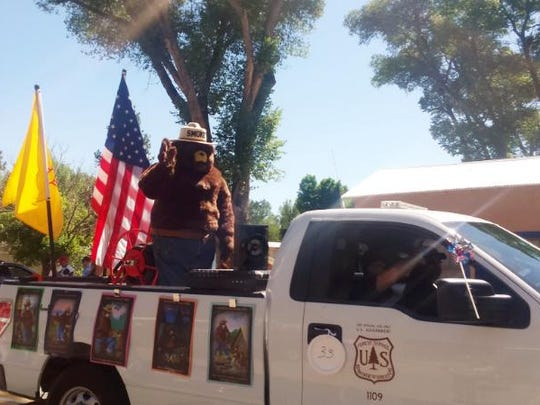 Smokey Bear waves to the crowds at the Village of Capitan's