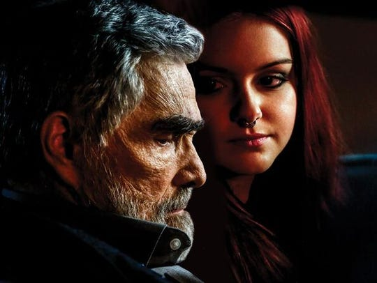 Burt Reynolds, left, and Ariel Winter in a still from