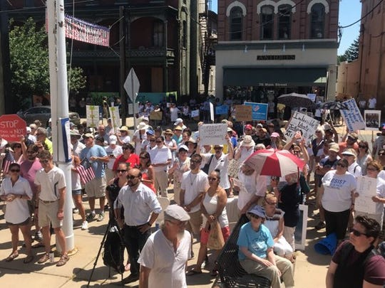 Protesters at the Flemington Families Belong Together rally on Saturday.