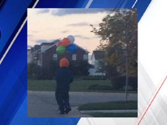 A Fishers resident sent FOX59 a photo of someone dressed as a clown holding balloons and walking in the area of 126th Street and Olio Road.