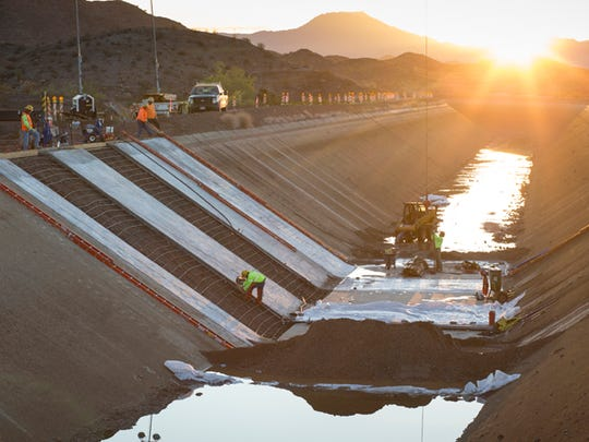 Crews work to repair a breach in the Central Arizona Project canal  in 2012.