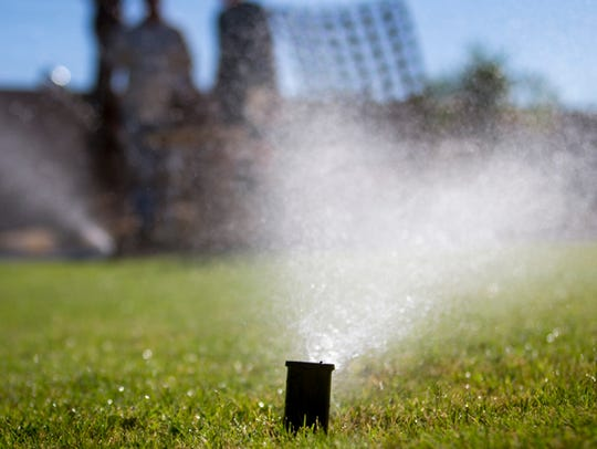 Scottsdale water conservation specialists perform a