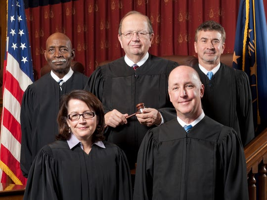 This updated photo provided by the Indiana Supreme Court on June 18, 2014 shows the members of the Indiana Supreme Court.  The are: Justice Robert D. Rucker, top left, Brent E. Dickson, Chief Justice, top center, Justice Steven H. David, top right; Justice Loretta H. Rush, bottom left; Justice Mark S. Massa. It's only been two years since Brent Dickson was named Indiana chief justice to lead an almost entirely new state Supreme Court. The Judicial Nominating Commission will meet Wednesday, Aug. 6, 2014 to interview Justices Rush, Massa, David and Rucker before selecting a new chief justice to succeed Dickson. (AP Photo/Indiana Supreme Court)
