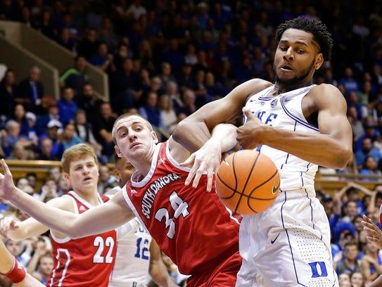 Duke's Marques Bolden and South Dakota's Nick Fuller