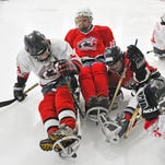 Space Coast Hurricanes sled hockey practice Sunday at the Space Coast Iceplex in Rockledge.