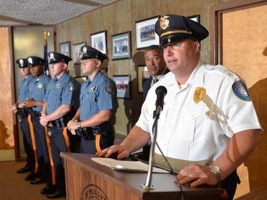 Millville police Chief Jody Farabella (right at podium)