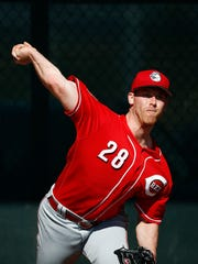 Cincinnati Reds Anthony DeSclafani throws a pitch at the team's baseball spring training facility Monday, Feb. 20, 2017, in Goodyear, Ariz. (AP Photo/Ross D. Franklin)