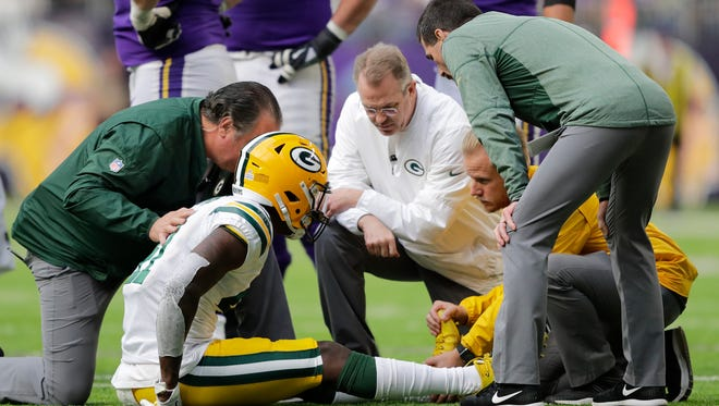 Green Bay Packers cornerback Lenzy Pipkins (41) is looked at after getting injured in the third quarter against the Minnesota Vikings during their football game Sunday, October 15, 2017, at U.S. Bank Stadium in Minneapolis, Minn.
