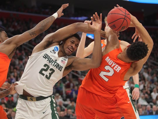 Michigan State forward Xavier Tillman rebounds against Syracuse forward Matthew Moyer during the first half in the second round of the NCAA tournament at Little Caesars Arena on Sunday, March 18, 2018.