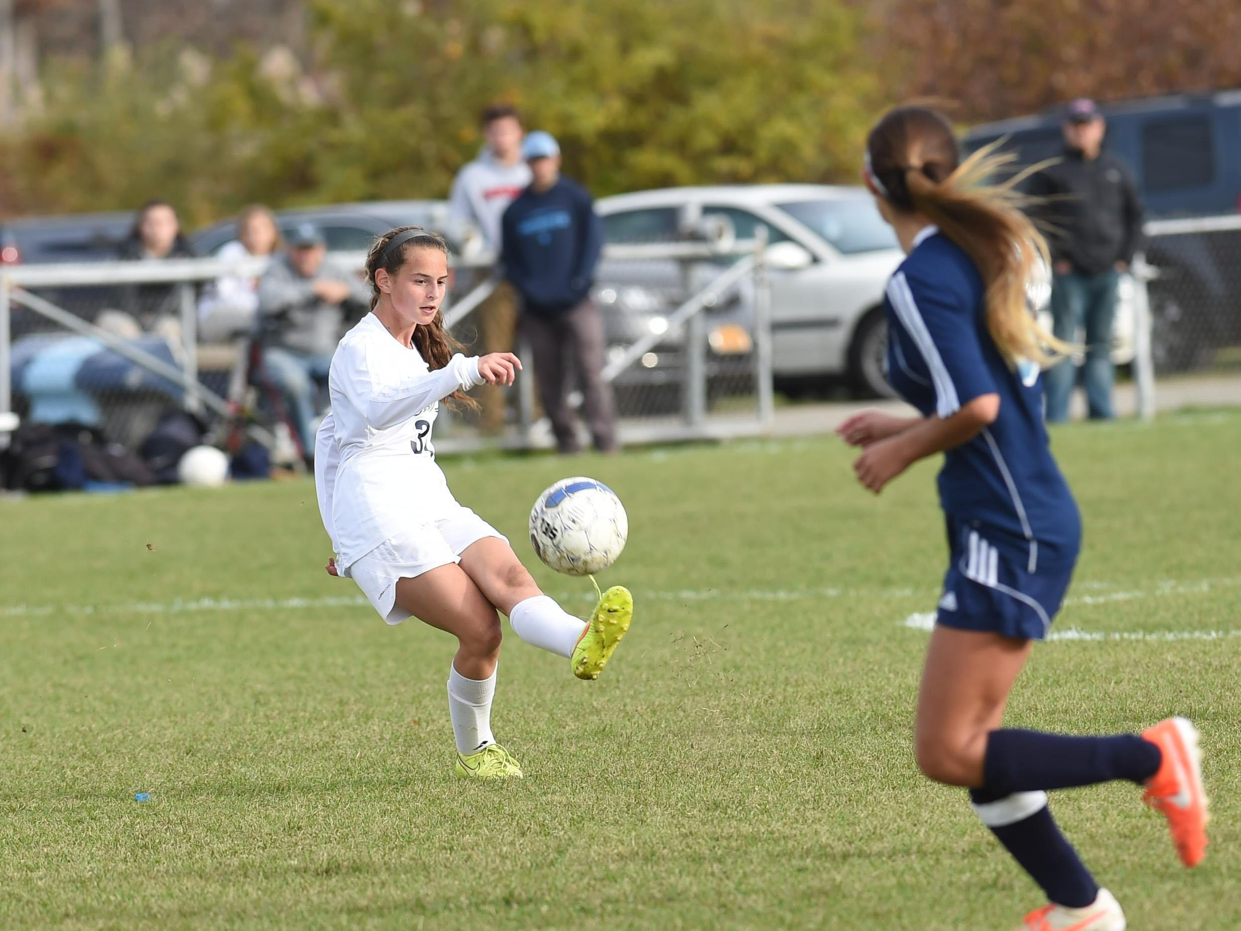 John Jay's Kiley Longin, left, kicks the ball down field during Tuesday's playoff game against Suffern.