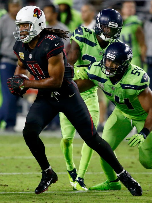 Arizona Cardinals wide receiver Larry Fitzgerald (11) runs after the catch as Seattle Seahawks middle linebacker Bobby Wagner (54) pursues during the second half of an NFL football game, Thursday, Nov. 9, 2017, in Glendale, Ariz. (AP Photo/Ross D. Franklin)