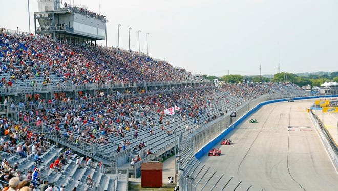 In this July 12, 2015, fans watch the IndyCar Series race at the Milwaukee Mile in West Allis.