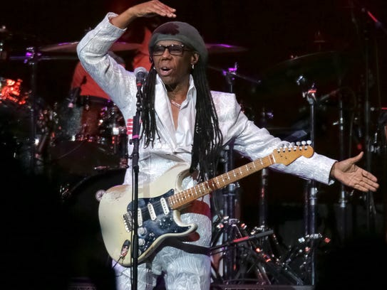 Guitarist/composer Nile Rodgers performs on stage with