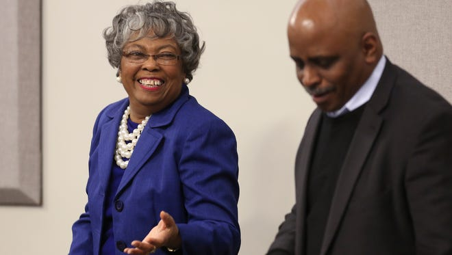 Councilwoman Mary Woolridge, left, shared a laugh with Councilman David James in council chambers after he notified her and the Democratic caucus that the plans to develop the methane plant in the city have been cancelled. Jan. 6, 2015