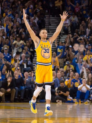 March 29, 2016; Oakland, CA, USA; Golden State Warriors guard Stephen Curry (30) celebrates against the Washington Wizards during the fourth quarter at Oracle Arena. The Warriors defeated the Wizards 102-94. Mandatory Credit: Kyle Terada-USA TODAY Sports
