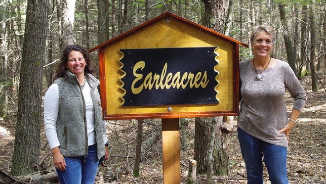 Leigh Youngblood, right, passes the torch to Mount Grace Land Conservation Trust's new executive director, Emma Ellsworth, left.