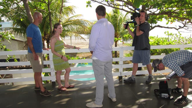 """Jeff and Natalie Hastings filming for HGTV's """"Overseas and Underpriced."""""""