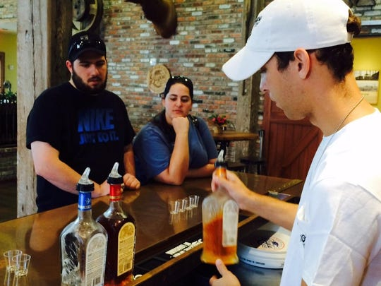 Tour guide Josh Thibodeaux serves up Louisiana Spirits products at the end of the 30-minute tour.