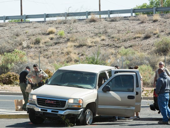 Doña Ana County sheriff's deputies and Las Cruces police officers chased a suspect in a stolen vehicle into the Villa Sierra apartments, where he then ran from the vehicle and climbed to the roof on a building. Wednesday 25, 2018.