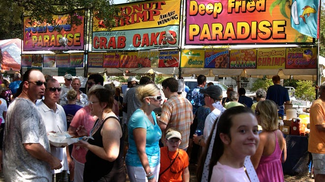 People crowd the east side of the Seville Square as they check out some of the food booths during a past Pensacola Seafood Festival.