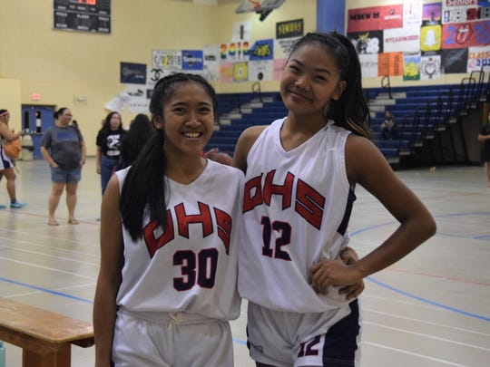 Vanezza Gustilo and D'Shanae Cruz of the Okkodo Bulldogs led their team to a victory over the Southern Dolphins in the IIAAG Girls High School Basketball Quarterfinals.