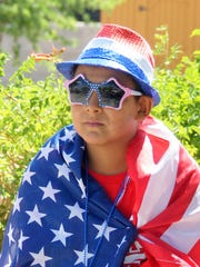 Sergio Yepez, 12, showed his true colors along the parade route on Tuesday.