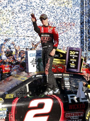 Oct 19, 2014; Talladega, AL, USA; NASCAR Sprint Cup Series driver Brad Keselowski (2) celebrates after winning the Geico 500 at Talladega Super Speedway. Mandatory Credit: Marvin Gentry-USA TODAY Sports