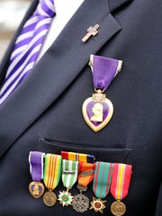 William Nazario, 70, of Cortlandt wears his medals,