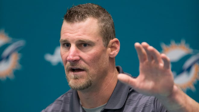 Dan Campbell gestures as he speaks during a news conference after being promoted to interim head coach,