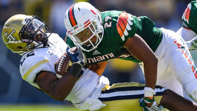 Miami defensive back Corn Elder (29) brings down Georgia Tech running back Clinton Lynch (22) on Oct. 1, 2016. Elder, who starred at Ensworth, is expected to take part in the Senior Bowl on Saturday.