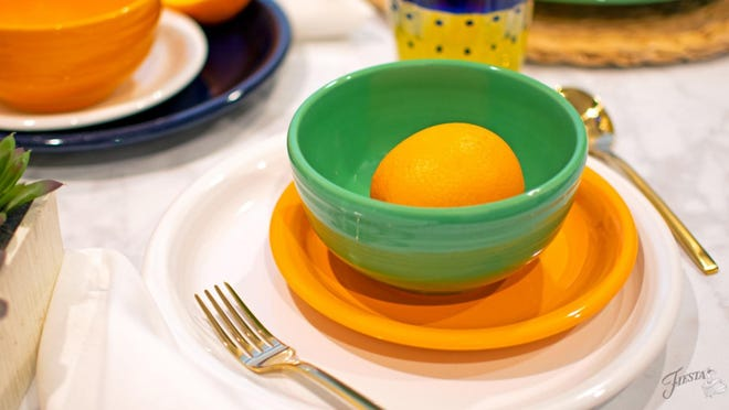 "The Fiesta website's blog calls this color combination ""classic elegance"": a meadow bowl sits on a small plate of butterscotch, the manufacturer's 2020 color of the year. Other Fiesta colors in the setting are ivory and cobalt."