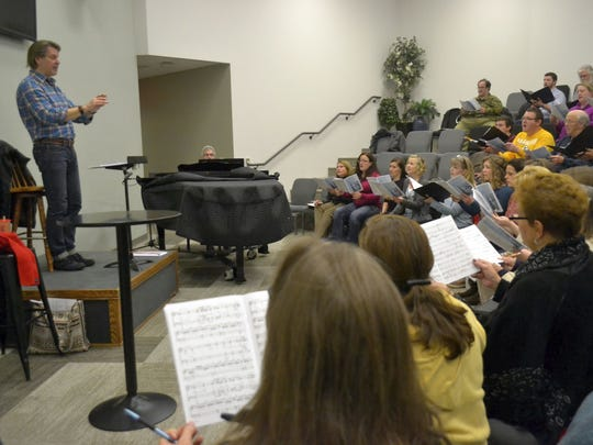 Phillip Swan, left, conducts the newVoices choir during a rehearsal at Appleton Alliance Church on Sunday night, Dec. 4, 2016, for its upcoming Christmas concerts in Green Bay and Appleton.