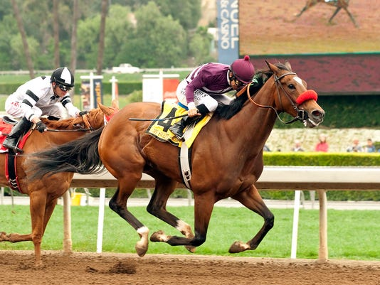 In this image provided by Benoit Photo, My Sweet Addiction (4), with Mike Smith aboard, outruns Warren's Veneda, with Tyler Baze aboard, to win the Grade I $300,000 Vanity Stakes horse race Saturday, May 9, 2015, at Santa Anita Park in Arcadia, Calif. (Benoit Photo via AP) NO SALES