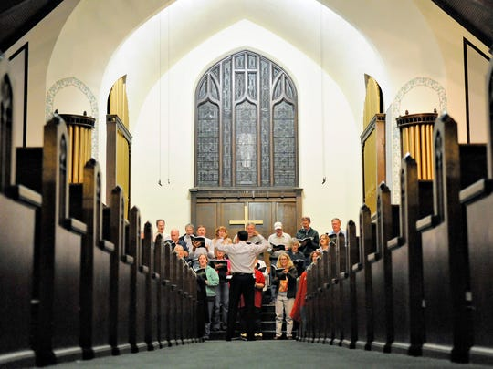 A choir at First Presbyterian Church of St. Cloud  rehearses in the sanctuary Wednesday  for its  performance Sunday when the church celebrates its 150th anniversary.