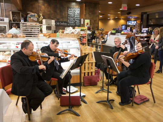 Members of the Delaware Symphony String Quartet perform at the dinner.
