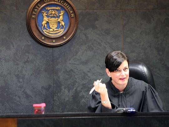 Oakland County Family Court Judge Lisa Gorcyca listens