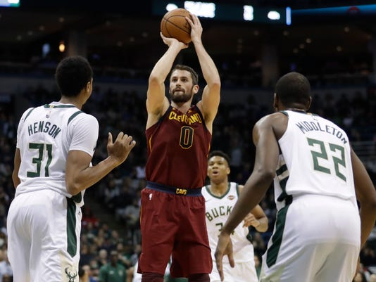 Cleveland Cavaliers' Kevin Love shoots during the first half of an NBA basketball game against the Milwaukee Bucks Tuesday, Dec. 19, 2017, in Milwaukee. (AP Photo/Morry Gash)
