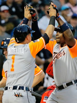 Tigers leftfielder Justin Upton, right, is congratulated by shortstop Jose Iglesias after hitting a two-run home run against the White Sox during the third inning on Saturday, Aug. 26, 2017, in Chicago.