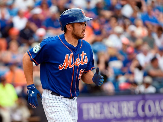 Mets catcher Travis d'Arnaud (18) has struggled to throw out runners this spring. Base stealers, in fact, are 12-for-12 against d'Arnaud.