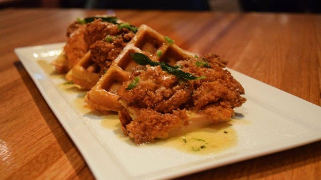 Chicken and waffles are on the menu at 7th Avenue Social in Naples.