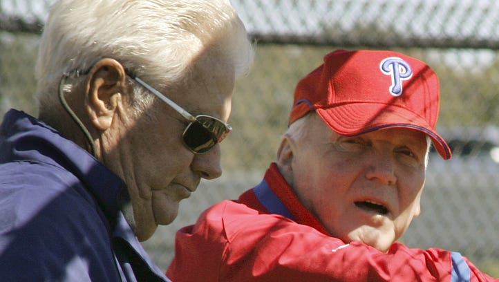 Phillies manager Charlie Manuel, right, talks with former manager Dallas Green on the first day of spring training in 2008.