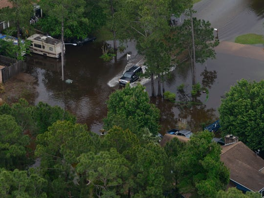 In this 2014 file photo, areas of Gulf Breeze remain underwater after severe storms in the area. Stormwater drainage is among the infrastructure issues for Santa Rosa County.