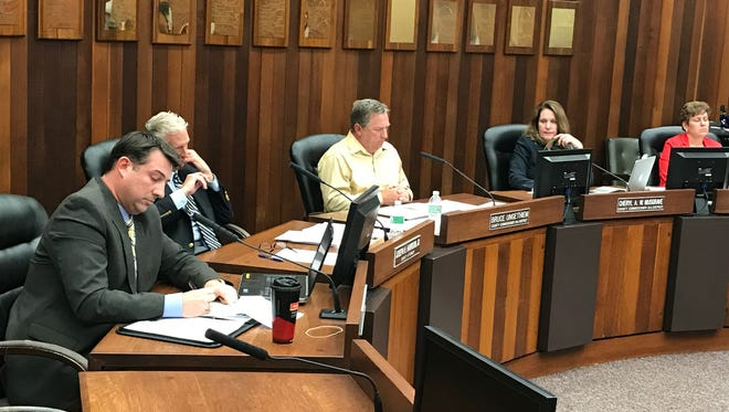 Vanderburgh County Commissioners listen to members of the public speak during a meeting March 21, 2017.