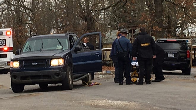 Emergency personnel work the scene of a shooting Tuesday morning in the 5900 block of Old Military Road. Preliminary information indicates at least one person has been shot and a suspect has been detained.