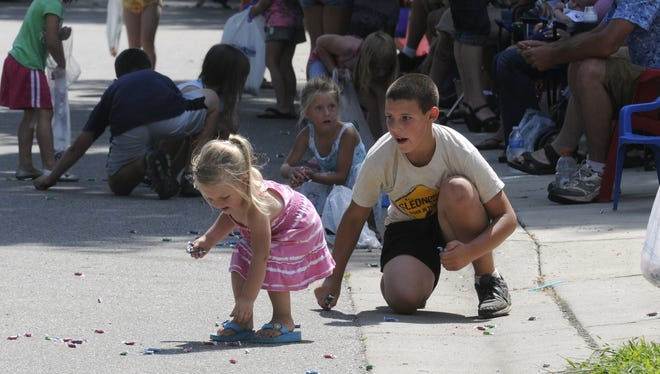 Children pick up candy during the Kimball Days parade in 2011.