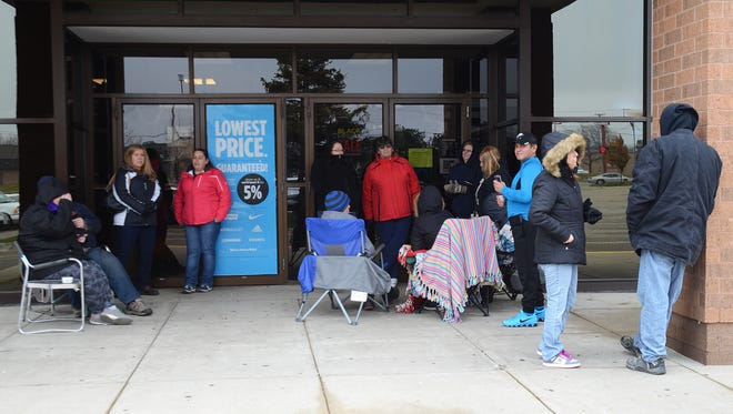 Shoppers wait outside of Birchwood Mall in Fort Gratiot on Thursday afternoon. The mall is opened at 3 p.m. Thanksgiving Day for early sales before Black Friday.
