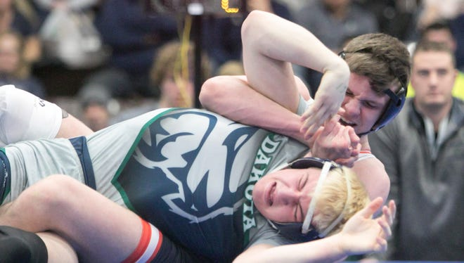 Brighton's Nick Bleise beat Macomb Dakota's Christian Karges, 4-2, at 152 pounds to clinch the Bulldogs' 33-23 victory in the state Division 1 semifinals on Saturday, Feb. 24, 2018 in Kalamazoo.