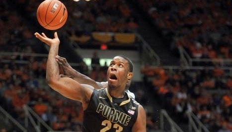 Purdue forward Jay Simpson puts up a shot over Illinois guard Rayvonte Rice (24) during the second half of an NCAA college basketball game Wednesday, Jan. 15, 2014, in Champaign, Ill. (AP Photo/Rick Danzl)