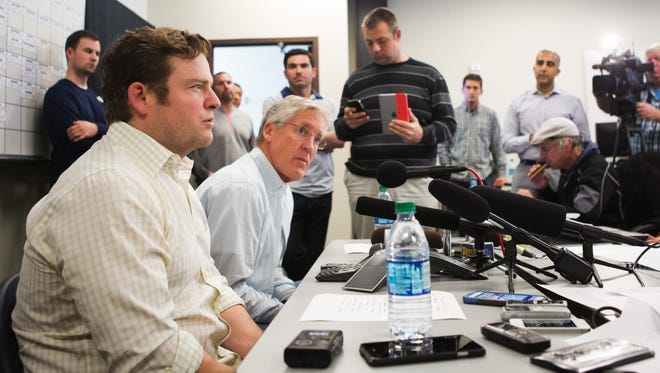 Seattle Seahawks oach Pete Carroll and general manager John Schneider, front, speak with reporters in Renton, Wash. on Saturday, April 30, 2016, after the end of the NFL football draft. The Seahawks made 10 draft picks over the 7 rounds, concluding with running back Zac Brooks as the 247th pick. (Lindsey Wasson/The Seattle Times via AP)